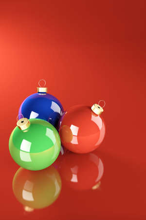 teknik: Christmas balls isolated over a red background. Stockfoto