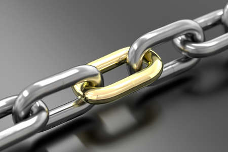 Chain with golden link isolated over a gray background. photo