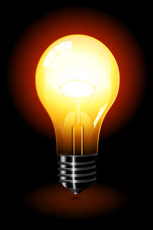 Bright light bulb standing isolated over a black background.