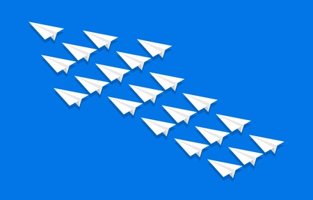 Paper planes group flying in the shape of an arrow