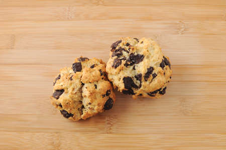 chocolate chip scone cookies isolated on cutting board