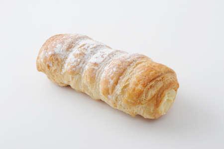 Cannoli cornet with cream pastry isolated on white background