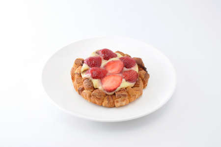 strawberry cake with custard cream on a plate on white background