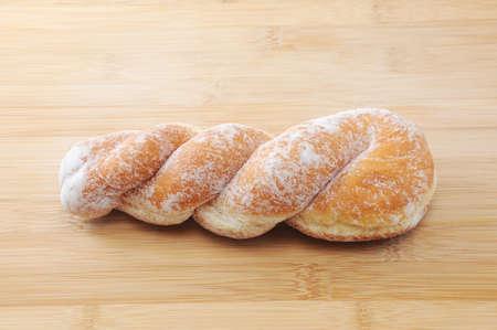 sugared twist donuts on cutting board