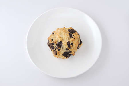 chocolate chip scone cookies on plate isolated on white background