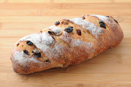 french bread with raisin isolated on cutting board Reklamní fotografie