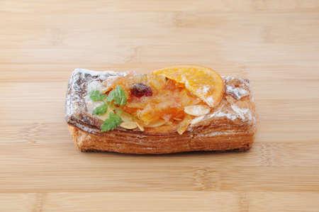 orange marmalade tart pie on plate cutting board