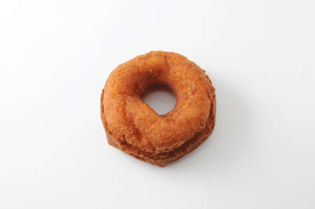 doughnut on a plate on white background Imagens