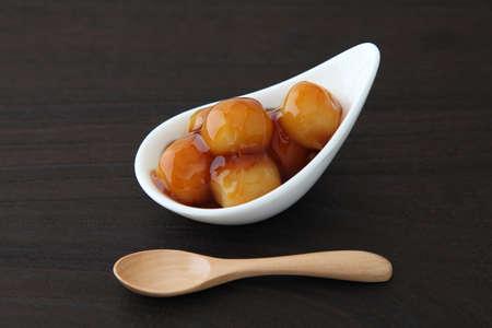 dango dumpling Japanese sweet dessert with rice on plate on table mitarashi