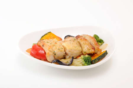 grilled chicken with vegetable on plate on white background