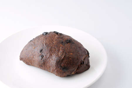 chocolate chip bread on plate on white background