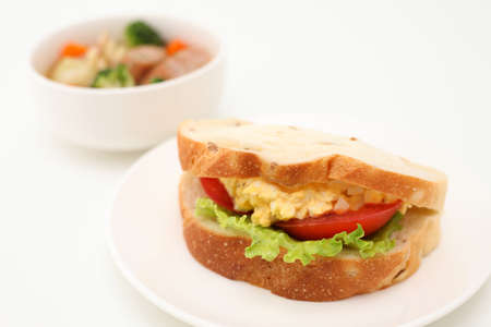 Sandwich with egg tomato lettuce with vegetable soup isolated on white background