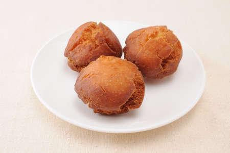 Sata Andagi okinawa dough nuts on plate on table