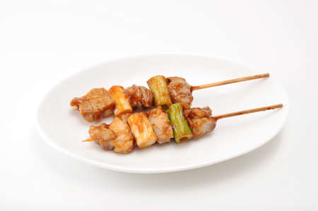 yakitori grilled chicken Japanese barbecue on plate on white background Archivio Fotografico - 124926828