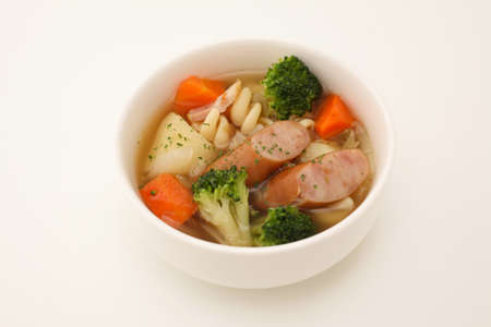 pot-au-feu vegetables sausage soup isolated on white background