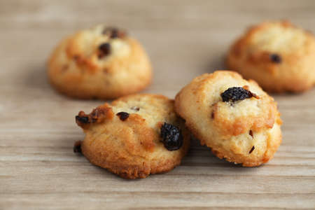 biscuit raisin cookies isolated on wood table