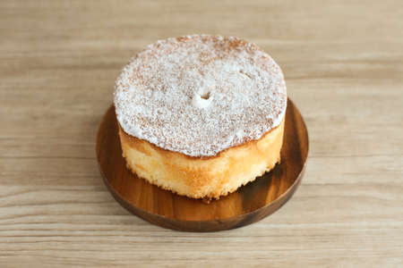 chiffon cake on wood plate isolated on table