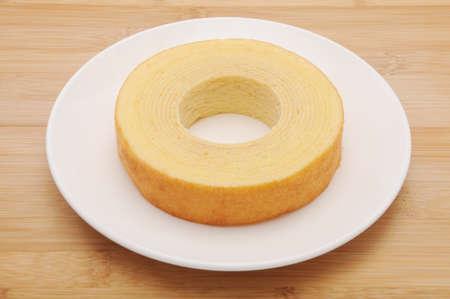 baumkuchen German doughnut cake on plate on table