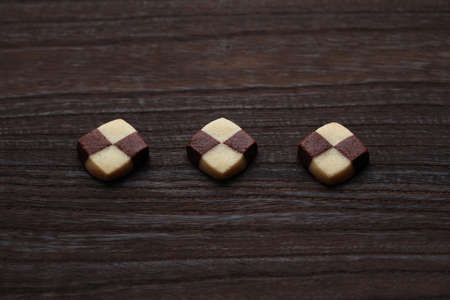 butter milk chocolate cookies biscuits isolated on wood table