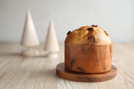 panettone italian raisin dried fruit cake for Christmas isolated on table