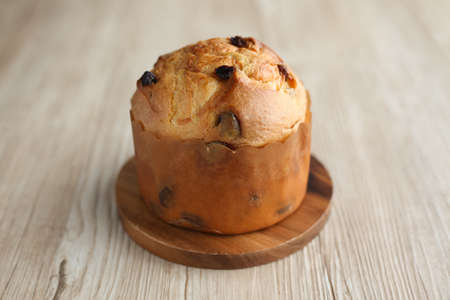 panettone italian raisin dried fruit cake for Christmas isolated on table