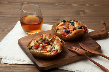 chicken vegetable focaccia pizza bread with tea isolated on wooden table top