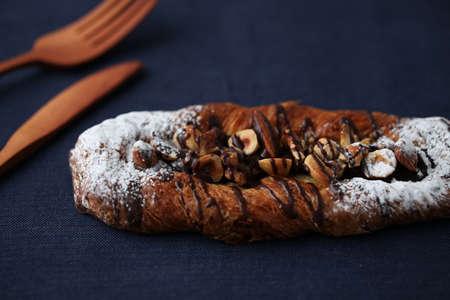 chocolate almond nuts walnut hazelnuts danish bread isolated on table Stock Photo