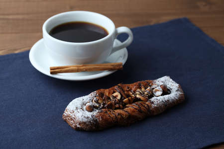 chocolate almond nuts walnut hazelnuts danish bread with hot coffee isolated on table Stock Photo