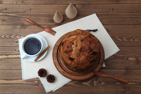 panettone italian fruit cake for Christmas with cup of coffee isolated on table