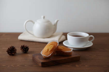 cup cakes on wooden table with tea pot cup