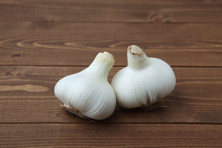 raw garlic isolated on wooden table