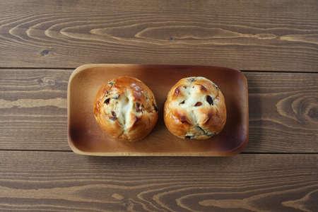 raisin bread isolated on wooden table