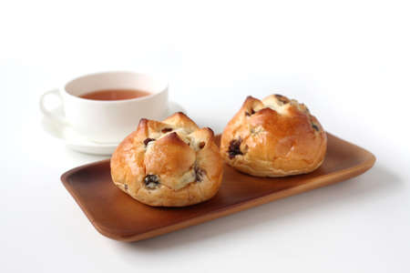 raisin bread with English tea isolated on white background
