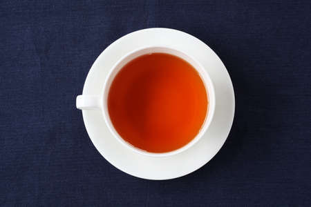 cup of tea isolated on table cloth