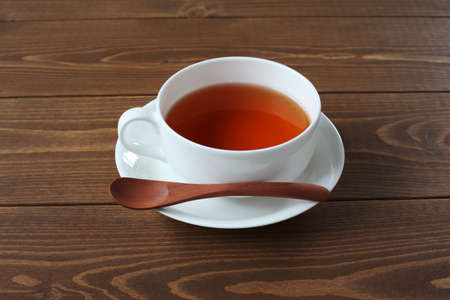 cup of tea isolated on wooden table