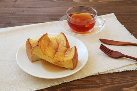 french toast and cup of tea isolated on table