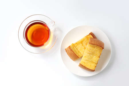 2 pieces of french toast and cup of tea isolated on white background 写真素材