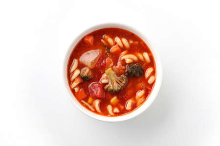 minestrone vegetables tomato soup with pasta closeup isolated on white background
