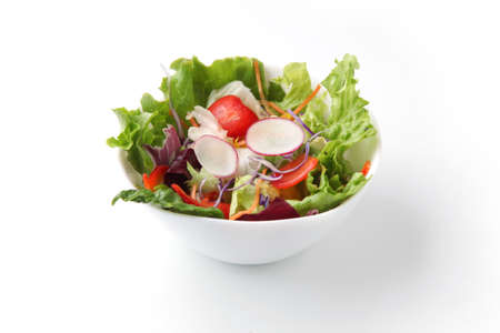 fresh green salad in bowl closeup isolated on white background Imagens