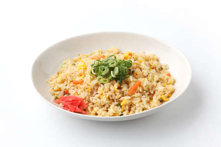 fried rice on plate closeup isolated on white background