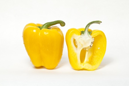 Whole yellow bell pepper and cut in half yellow bell pepper
