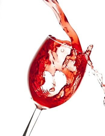 Pouring Cranberry juice in Wine glass Stock Photo