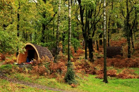 Camping Pods in trees Lake district Stock Photo