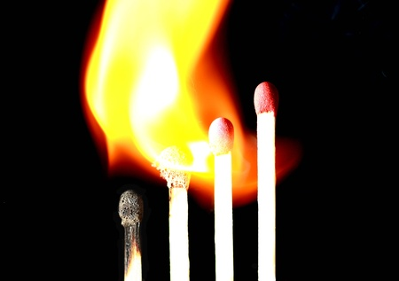Matchstick in line catching fire Stock Photo