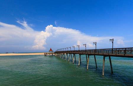 Wooden bridge on beach and sea view. Stock Photo