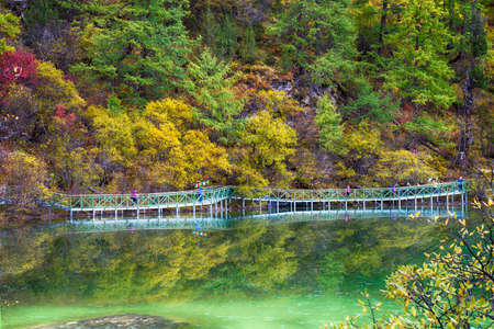 reflect: Bridge and Reflect from Yading National Reserve Stock Photo