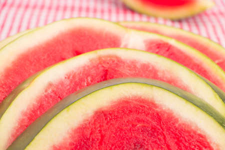 red tablecloth: Fresh watermelon slices on a red tablecloth