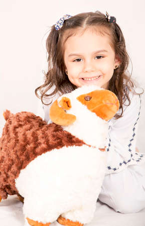 Happy little girl playing with her sheep toy - celebrating Eid ul Adha - Happy Sacrifice Feast Standard-Bild