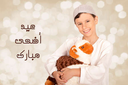 Happy little boy playing with his sheep toy - celebrating Eid ul Adha - Happy Sacrifice Feast