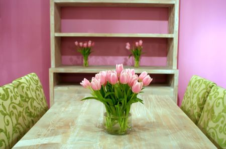 fresh decoration by spring tulips in interior